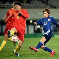 Japan's World Cup hopefuls seize chance in win over China