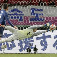 Japan's Kosuke Nakamura makes a save against North Korea during the second half on Saturday night. Japan won 1-0. | KYODO