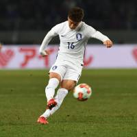 South Korea's Jung Woo-young scores on a free kick on Saturday. | AFP-JIJI