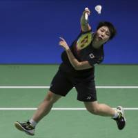 Ayane Yamaguchi plays a shot during her World Super Series Finals match against India's Pusarla V Sindhu in Dubai, United Arab Emirates, on Sunday.   AP