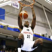 Alvark forward Jawad Williams dunks in the second quarter against the SeaHorses on Saturday in Kariya, Aichi Prefecture. Tokyo beat Mikawa 77-74. | KYODO