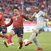 Grampus come through playoff to seal return to J. League top flight