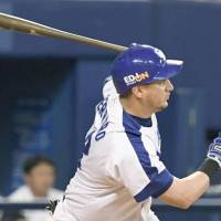 New Giants acquisition Alex Guerrero, seen playing for the Dragons, led the Central League with 35 home runs in 2017. | KYODO