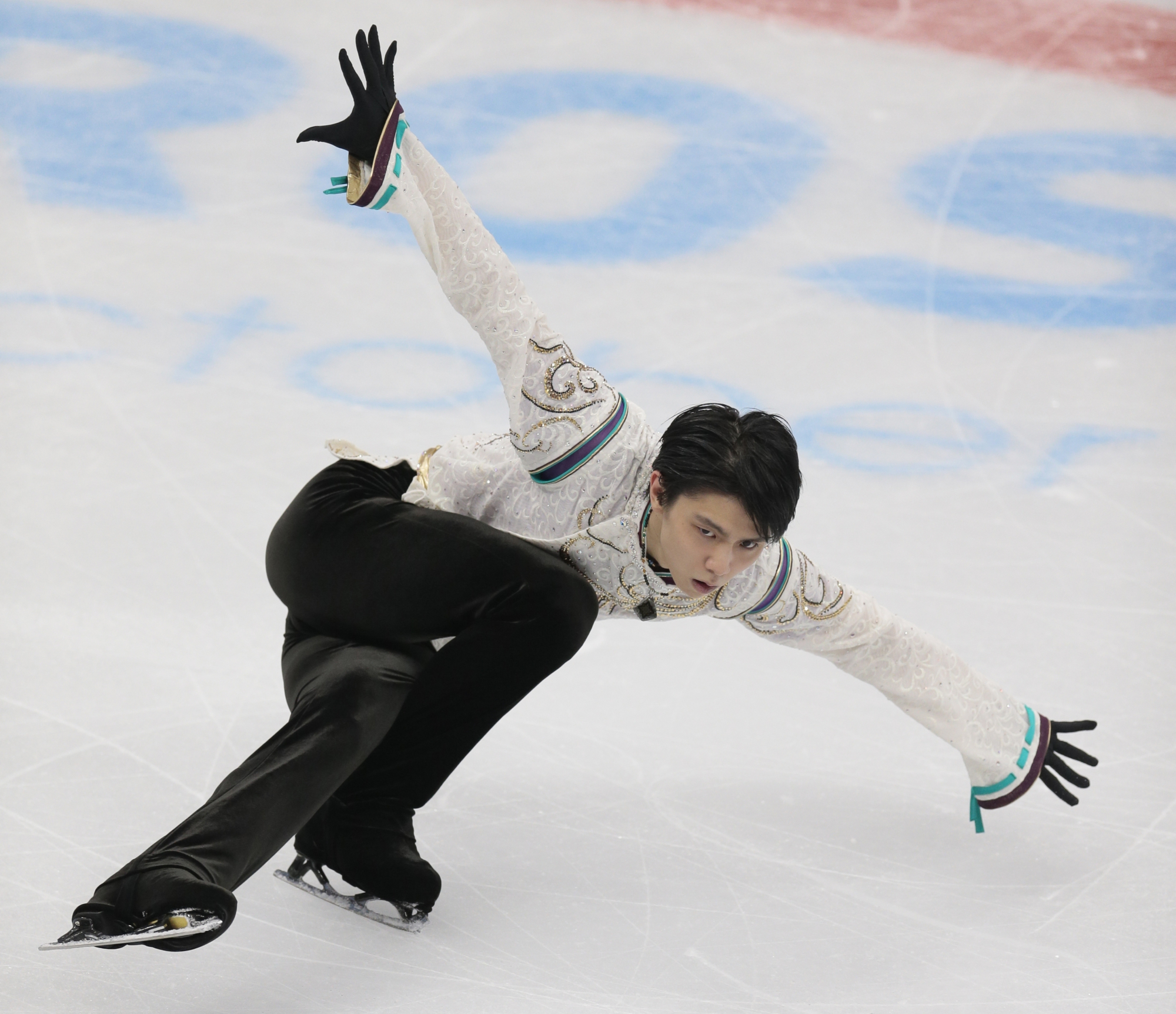 Yuzuru Hanyu's status for the national championships is still in doubt because of an injury he suffered last month. | AP