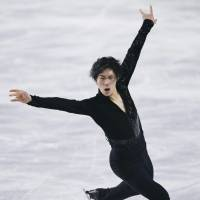 Keiji Tanaka skates to 'Memories' in the men's short program on Friday. He is in second place with 91.34 points.   KYODO
