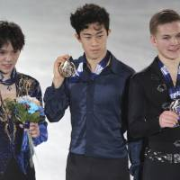 Winner Nathan Chen (center), runner-up Shoma Uno and third-place finisher Mikhail Kolyada are seen on the podium after the men's free skate at the Grand Prix Final.   AP