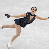 Canada's Kaetlyn Osmond skates in the women's short program at the Grand Prix Final on Friday in Nagoya. Osmond sits in first place with 73.04 points.   REUTERS
