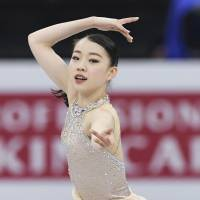 Rika Kihira skates to 'Kung Fu Piano' in the women's short program at the Junior Grand Prix Final. Kihira sits in fourth place with a personal-best 66.82 points. | KYODO