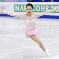 Satoko Miyahara performs her short program at the Grand Prix Final on Friday night. Miyahara is in third place with 74.61 points.   KYODO