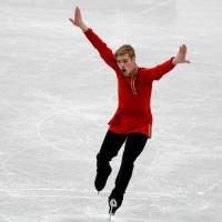 Alexei Krasnozhon is in first place after receiving 81.33 points in the men's short program in the Junior Grand Prix Final on Thursday. | REUTERS