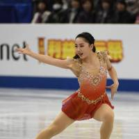 Wakaba Higuchi skates in the women's short program. She sits in fifth place with 73.26 points.   AFP-JIJI
