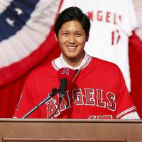 The Angels' Shohei Ohtani speaks during his introductory news conference on Saturday in Anaheim, California. | KYODO