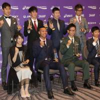 Yoshihide Kiryu (second from the right in the back row), Abdul Hakim Sani Brown (second from the left in the front row) and other award recipients pose for photos at the JAAF Athletics Award 2017 event in Tokyo on Tuesday. | KAZ NAGATSUKA