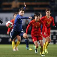 Japan's Mina Tanaka (left) chases the ball during her team's 1-0 win over China on Monday at the E-1 Football Championship in Chiba. | KYODO