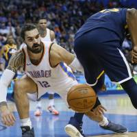 Oklahoma City's Steven Adams (left) knocks the ball away from Utah's Derrick Favors during the Thunder's 100-94 win on Tuesday. | AP