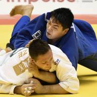 Yusei Ogawa (top) takes on Lukas Krpalek of the Czech Republic during the men's over-100-kg final at Grand Slam Tokyo on Sunday. | KYODO