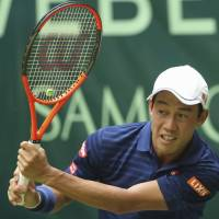 Kei Nishikori plays a shot during a match at the Gerry Weber Open in Halle, Germany, on June 22. | AP