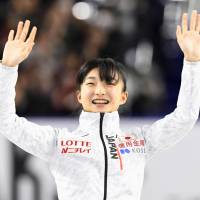 Kaori Sakamoto waves to the crowd after being chosen as a member of Japan's figure skating team for the 2018 Pyeongchang Olympics following the national championships in Tokyo on Sunday night. | KYODO
