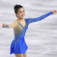 Satoko Miyahara celebrates after her enchanting performance to 'Madame Butterfly' in the women's free skate at the All-Japan Championships on Saturday night at Musashino Forest Sports Centre. Miyahara won her fourth straight national title. | KYODO