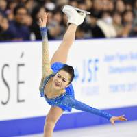 Satoko Miyahara competes in the free skate on Saturday evening at the All-Japan Championships. | KYODO