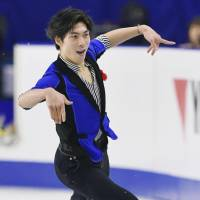 Keiji Tanaka performs his free-skate routine on Sunday, en route to a runner-up finish at the All-Japan Championships. | KYODO