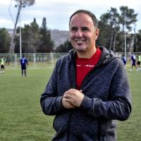 FK Adrija coach Pedja Stevovic poses for photos during a training session on Nov. 17 in Podgorica, Montenegro. The team has three Japanese players, several Japanese board members and a Japanese assistant on staff. | AFP-JIJI