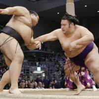 Takakeisho (right) could challenge sumo's leading lights next year after an impressive 2017, which included an 11-4 runner-up finish at the Kyushu Basho. | KYODO