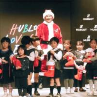 Yankees pitcher Masahiro Tanaka dresses as Santa Claus for an event on Tokyo on Wednesday. | KYODO