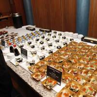 Guests are served various Japanese delicacies, including sake and sushi, at the 2017 Japan Night event. | THE JAPAN NIGHT ORGANIZATION COMMITTEE