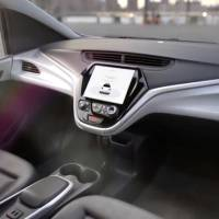 GM's planned Cruise AV driverless car, which features no steering wheel or pedals, is seen in a still image taken from video released Friday. | REUTERS