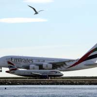 An Emirates Airbus A380 airliner lands at Nice international airport in France Thursday. | REUTERS