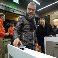 Grab and go: Amazon opens Seattle store with no cashiers