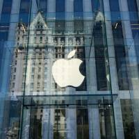 The Apple logo is seen at the entrance to the Fifth Avenue Apple store in New York in 2016. Apple announced Wednesday it would pay some $38 billion in taxes — likely the largest payment of its kind — on profits repatriated from overseas as it boosts investments in the United States.The iPhone maker said in a statement it plans to use some of its foreign cash stockpile of more than $250 billion, which qualifies for reduced tax rates under a recent bill, to invest in new projects, with estimated investments of $75 billion in the U.S. | AFP-JIJI