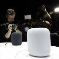 The HomePod speaker is photographed in a showroom during an announcement of new products at the Apple Worldwide Developers Conference in San Jose. Pre-orders for the HomePod will begin Friday in the U.S., U.K. and Australia, two weeks before the speaker goes on sale in stores. | AP