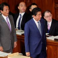 Prime Minister Shinzo Abe attends a Diet session with Deputy Prime Minister and Finance Minister Taro Aso on Monday. | REUTERS