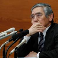 Gov. Haruhiko Kuroda attends a news conference at the Bank of Japan on Tuesday. | REUTERS
