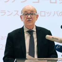 French Foreign Affairs Minister Jean-Yves Le Drian speaks in Tokyo on Monday. | KYODO