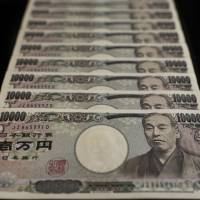 The Bank of Japan believes there is little need for digital currency in Japan, where cash is still king. | BLOOMBERG