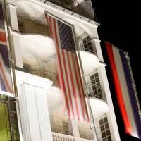 National flags of the United Kingdom, United States of America, France and Russia hang in front of the Steigenberger Belvedere hotel in the Swiss mountain resort of Davos Thursday. | REUTERS
