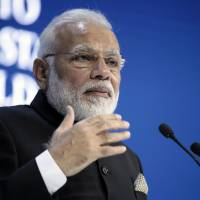 At Davos, Modi calls out isolationist trends as attention turns to how Trump will respond