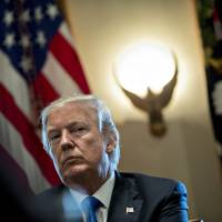 U.S. President Donald Trump listens during a meeting on immigration with bipartisan members of Congress, in the Cabinet Room of the White House in Washington on Jan. 9. Trump is set to travel to Davos, Switzerland, for the World Economic Forum this week.   BLOOMBERG