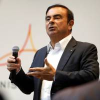 Carlos Ghosn, chairman and CEO of the Renault-Nissan-Mitsubishi Alliance, responds to a question on the alliance's new venture capital fund during a roundtable with journalists at the 2018 CES in Las Vegas on Tuesday. | REUTERS