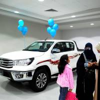 Saudi women tour a car showroom for women on Thursday in the Saudi Red Sea port city of Jeddah. | AFP-JIJI