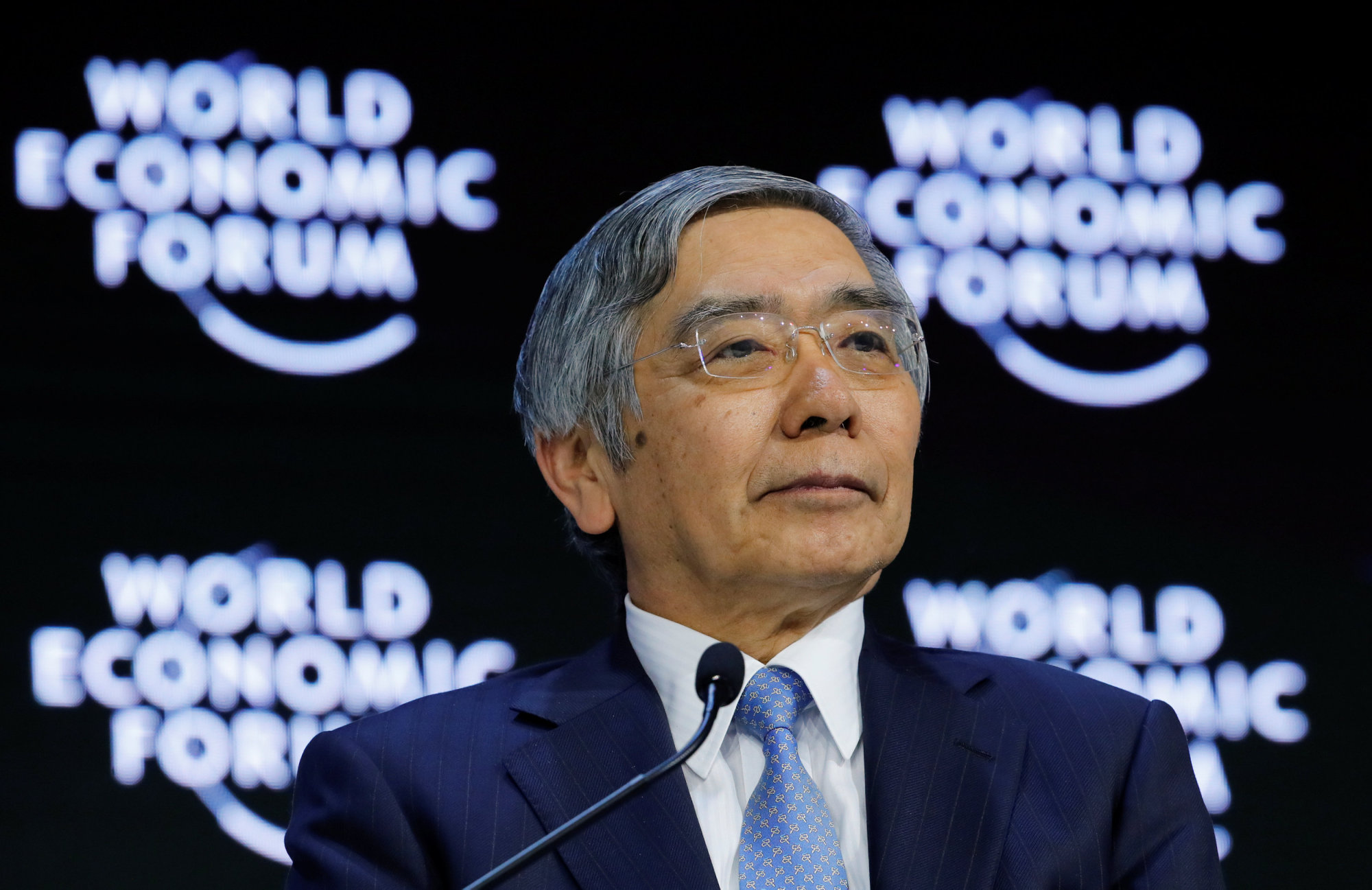 Bank of Japan Gov. Haruhiko Kuroda looks on as he attends the World Economic Forum's annual meeting in Davos, Switzerland, on Friday. | REUTERS