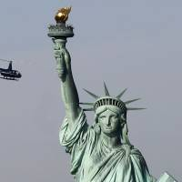N.Y. governor vows to tap state funds to reopen Statue of Liberty as shutdown enters Day 2