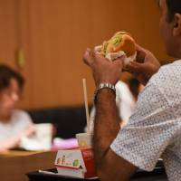 McDonald's chalked up higher sales in 2017 thanks to the winter Gracoro burger and special chicken nugget sauces. | BLOOMBERG