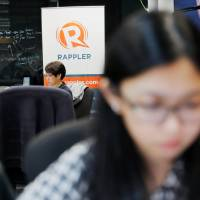 Journalists work at the office of Rappler in Pasig, Metro Manila, Monday. | REUTERS