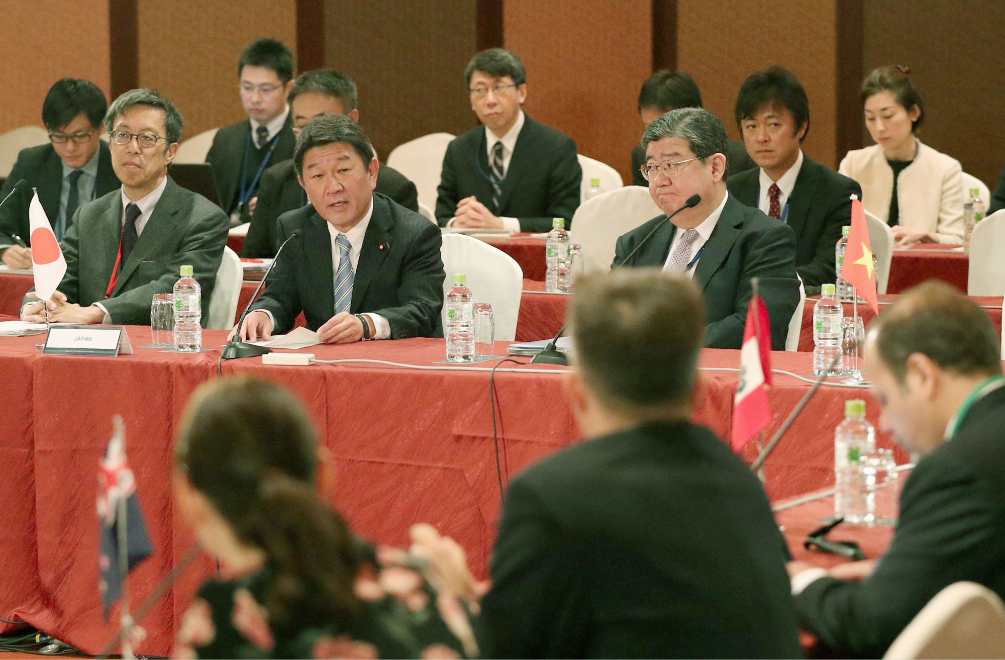 Toshimitsu Motegi, Japan's minister in charge of the Trans-Pacific Partnership, speaks at a two-day meeting of chief negotiators from the other participating nations. | KYODO