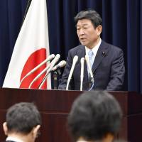 Toshimitsu Motegi, the government's minister in charge of TPP issues, speaks at a news conference on Tuesday in Tokyo. | KYODO