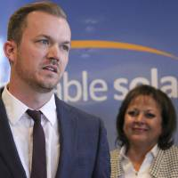 Affordable Solar President Kevin Bassalleck talks about the full-time positions his company will create as New Mexico Gov. Susana Martinez listens during a news conference in Albuquerque last February.   AP